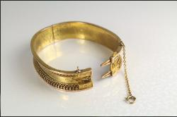 One bangle, a pair with silk box sold for $2000