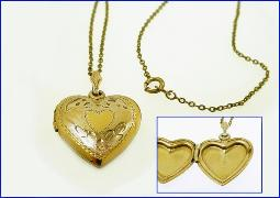 Locket with charming engraved design is marked 1/20 12K G.F.