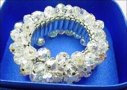 Silver expansion bracelet loaded with crystal stones