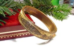 Embellished etched golden colored est. c. 1930s bangle bracelet