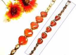 Beautiful carved carnelian hearts are warmed up even more with golden setting