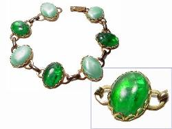 Bintage link bracelet with alternating stones with green hues.