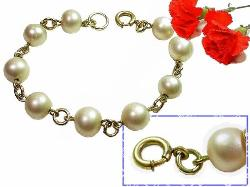 Antique pearl. Sim pearls surround the entire bracelet; closes with a thumbless nib-less spring ring.