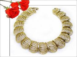A very pretty golden woven high arched vintage bracelet.