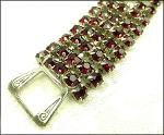 Deep red rhienstones all prong set in silvertone, art deco clasp