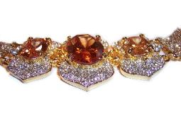 Giant crystal amber topaz stones joined as a pave set