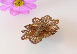 Open filigree work with c catch on reverse antique brooch