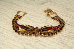 An absolutely striking red glass navette and rs rhinestone golden vintage bracelet