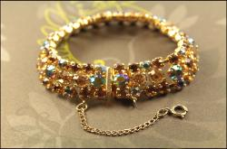 Shimmering colors of heliotrope chatons golden bracelet with safety chain
