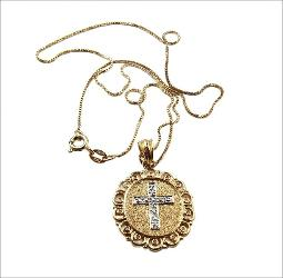 A beautiful golden necklace and silver cross signed Italy