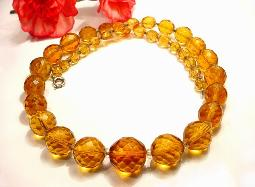 Heavy antique amber facet cut glass beads with a thumbless spring ring necklace