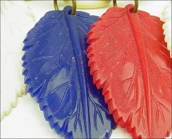 Intricate Carved Leaves, Red white blue celluloid plastic leaf necklace