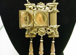 Brass/Metal two columns are adorned with a double photo locket