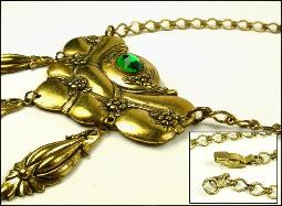 Art Nouveau stamped necklace with a single set oval rose cut glass stone