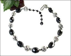 Silvertone And Black Necklace