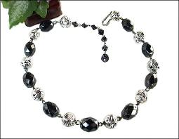 Silvertone beads, and black glass necklace