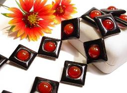 Fabulous square black glass or onyx with carnelian round centers