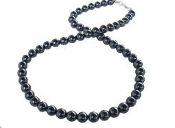 Round black pearl strand has a black hue with a hint of navy necklace