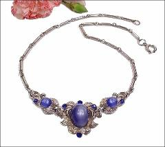 Vintage necklace, center has 3 blue cabs in detailed setting