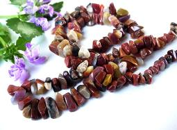 A continued strand of brown tones nugget necklace