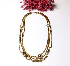 Beautiful draping necklace of multiple golden box link chains and beauty