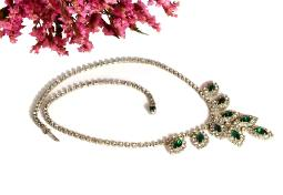 Stylish Deep green marquise stones accented with clear chaton rhinestones