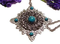 Great looking heavy filigree with turquoise lucite stones