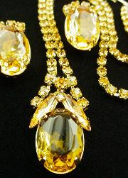 Shimming with small and large stones is the yellow topaz set