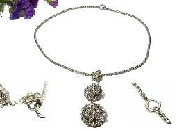 Rhinestone pendant necklace, center has three sections of clear rhinestones