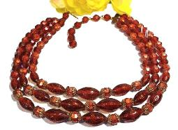 Three strands drapes eloquently, bead necklace