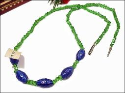 Designer signed Czechoslovakia green strand with ocean blue glass stones in front