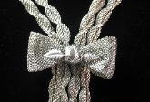 Vintage dramatic Bow ribbon necklace designer signed Continenta