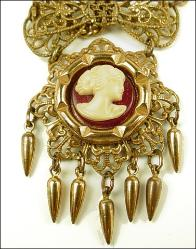 Antique Cameo Necklace simulated carnelian and ivory lucite cameo set on a decorative gold-tone frame