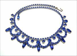 A stunning Festoon Necklace filled with blue rhinestones