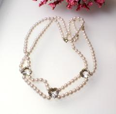 Designer Korea vintage necklace which features 2 strands of sim pearls