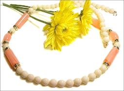 White Round Beads and Pink Barrel Beads