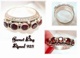 The beautiful ring holds 5 large garnets across the front
