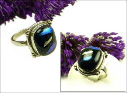 Black with hues of blue, teal blue, and silver inclusions Size 8