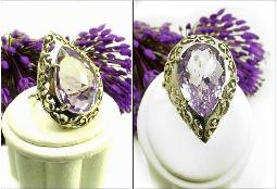 Centered with a heavy and larger pink multi cut pear amethyst stone, Size 8.5 - 9