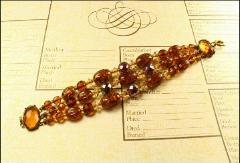 1900-1930's bracelet with 3 rich strands of amber topaz glass