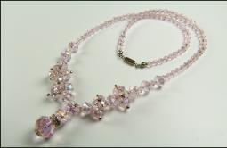 Amazing details in this crystal faceted translucent pink necklace