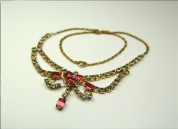 A beautiful festoon lavaliere necklace marked 1/20-12 KT