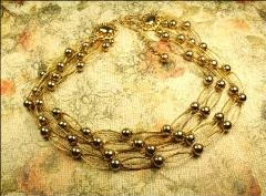 Signed KRAMER, a beautiful multi strand golden necklace