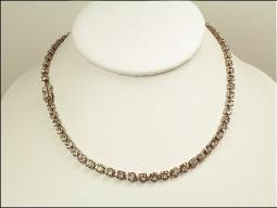 A simple one strand RS with an elaborate detailed clasp to wear on the side, front, or back