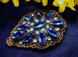 A Substantial Blues Dress Clip With Golden Filigree Design